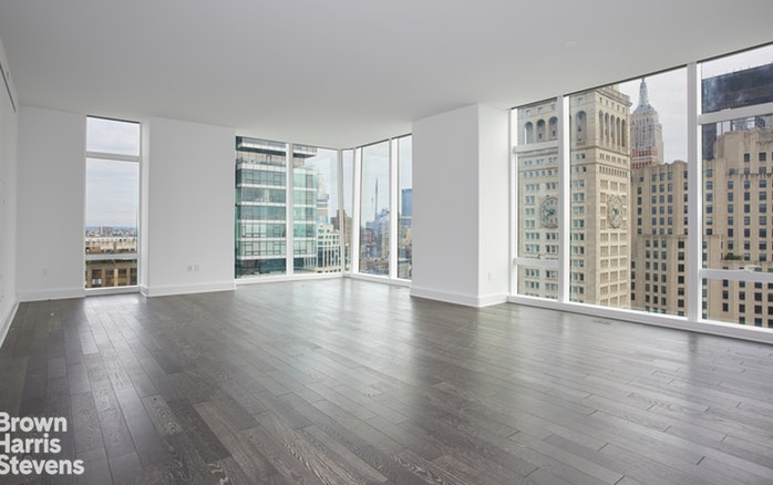 "This gorgeous 2 bedroom 2 bath corner home in Madison Square Tower comprises over 2000 sq. ft. and boasts infinite views north to the Empire State Building and the midtown skyline, west to the Hudson River and New Jersey, and south to the World Trade Center. It features an open living room and a beautifully detailed windowed kitchen replete with marble countertops and backsplash, Sub-Zero and Miele appliances, and custom cabinetry by Molteni. A separate wet bar with wine fridge is perfect for entertaining. The spacious master bedroom has an over-sized en-suite bathroom finely finished in marble with a double wood vanity, separate stall shower, and luxurious soaking tub. The huge walk-in dressing room is fitted with California Closets and measures over 15' x 6' 8"".  The second bedroom is generously proportioned and enjoys spectacular views.  Washer and dryer included.  Madison Square Tower is designed by world renowned architects Kohn Pedersen Fox with interior and amenity spaces designed by Martin Brudnizki. The impressive amenities include a fitness center, boxing suite, golf simulator, basketball court, playroom, library, billiards and cards room, terrace with outdoor grill, and two gracious entertaining spaces. Madison Square Tower is a full service condominium with full-time doorman, concierge, and live-in resident manager"