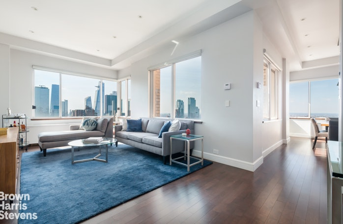 "On the top floor of Two Worldwide Plaza sits a gorgeous 39th floor Penthouse, with soaring southwest exposure framing views of Hudson Yards, One World Trade, the Empire State Building, the Hudson River and beyond. One of only four apartments on the floor, this 2-bedroom, 2.5 bath home was completely renovated in 2016 and is in immaculate condition.From your peaceful perch overlooking Manhattan, entertain and relax in a true eat-in chef's kitchen, fitted with a Subzero fridge, a Marvel wine fridge, a Bertazzoni Stove and convection oven, a Miele dishwasher and completed with a large ""chef's table.""A split bedroom layout offers maximum privacy, while the corner living room and windowed-kitchen bring in sunlight all day.  The master bedroom features a walk-through dressing area and a luxurious ensuite master bath.  The bathrooms and powder room have been uniformly renovated with great attention to detail, completing this mint residence.Further, this apartment is distinguished by 10' ceilings, new hardwood strip flooring, excellent closet storage, and an in-home washer and dryer. The apartment is equipped with Hunter Douglas automated window treatments throughout with blackout shades in the bedroom.Worldwide Plaza is a full-service condominium with 455 units on 39-stories with a 24 doorman and a concierge. Residents of the building enjoy the TMPL GYM by David Barton, additional laundry rooms per floor and a private garden courtyard. The onsite garage operates 24 hours a day, provides valet services and offers competitive monthly rates. This convenient location offers superb access to subways, restaurants, Broadway shows, and more, while offering the quiet of home as you step into the lobby."