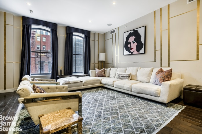Superbly spacious and luxuriously laid out two bedroom, two-and-a-half bathroom home at 250 West Street in Tribeca, whose winning features include stunning oversized arched windows, wide oak hardwood floors throughout, a separate home office/den and high ceilings.Open to the dining area, highlights of the chef's kitchen include top-of-the-line appliances, including Sub-Zero and Bosch, imported glass-tile backsplash, white quartz countertops, and Poggenpohl cabinetry. The master bathroom features double sinks and a 6-foot Catalina soaking tub, and both bathrooms are ensuite.Throughout, the owners have installed custom finishes including a stunning dressing room with center island for additional storage, gorgeous custom built-ins in the living room, a state of the art RTI home automation system, and a washer/dryer.250 West Street is an historic loft building converted to condominiums in 2014, with 24 hour doorman plus fitness center, swimming pool, sauna, 5,000 square foot common roof terrace, lounge, children's playroom, library, and more. The building fronts Hudson River Park, surrounded by world-famous restaurants, shopping, and other amenities that make Tribeca one of the City's most desirable neighborhoods. Close to the A/C/E and 1 Lines.