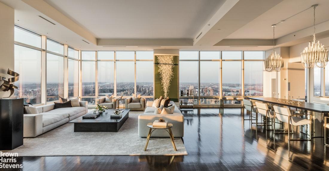 With over 2500 Square Feet of windows offering uninterrupted North, West and South exposures, this Penthouse has one of the more impressive views ever to hit the market. Through 200 linear feet of 12-foot high glass, you have an open vista spanning from the East River to the Hudson and from the Freedom Tower to the George Washington Bridge. at well over 750 feet in the sky, on a clear day, you can see beyond the rivers to the Poconos, Catskills, George Washington Bridge and even to the Atlantic Ocean and the Eifel Tower. The Northside of this expansive residence has a large loft-like corner living-room with an open dining area. This 34ft x 34ft room is the perfect place to unwind while enjoying the spectacular endless views of the entire upper half of Manhattan Island. The dining area leads to an eat-in kitchen with all the expected state-of-the-art appliances. Just like the north facade of the home is reserved for the public areas, the south facade reserved for the master suite. This is the ideal layout to have optimal natural lighting throughout different phases of THE day. When it is time to move from the public to the private quarters or vice versa, you do so by strolling down the central hallway. A 20'x 6' this gallery is perfectly proportioned for showcasing art. At 35'x19' the jaw-dropping master bedroom is one of the most palatial sleeping quarters anywhere. With separate his and hers bathrooms flanking a dressing room and two distinct walk-in closets, this is a gracious master suite. These four rooms each have wall to wall, floor to ceiling glass; a true standout even amongst its impressive peers. There is no building within six blocks in any direction so there will never be a need to close the curtains. The gallery between the public and the private quarters also offers access to two spacious bedrooms, each with an en-suite bathroom and ample closet. Each of these West facing bedrooms has the size and Park views that would make it a desirable master in any