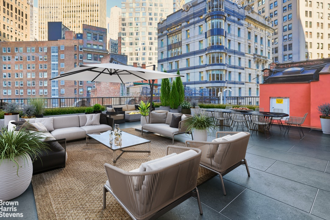 """With its large 1,200sf direct-living terrace, the Penthouse duplex at 54 Stone street is unique for the financial district.Everything about this place feels more like Soho, down to the Cobblestone street.That feeling is further enhanced by key locked elevator and the loft-like feeling of the home.Currently configured with 3 bedrooms, 4.5 baths, and 2 kitchens, this 4800sf space with 10 foot ceilings throughout and oversized windows on all 4 exposures, is a perfect canvas for the discerning buyer. After all, it will be difficult to find a space like this anywhere in the city.On the edge of one of Downtown's most iconic street, affectionally known as """"Restaurant Row"""", 54 Stone street is a """"stone's throw"""" from riverfront parks in every direction. It is also conveniently located near many well-known restaurants, as well as the South Street Seaport, Fulton Street Market and World class shopping. However, if you do need to leave the area, it is good to know the 1, 2, 3, 4, 5, R, J, Z, W, subway lines are all very close. And if your destination is off the island, it is only a short distance to multiple ferry terminals, the downtown helipad, the Battery Park tunnel and the Brooklyn Bridge."""