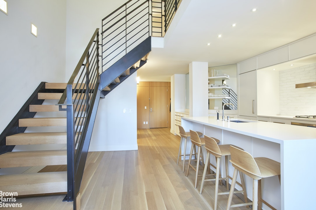 Welcome to the iconic Printing House in the heart of the West Village.Residence 807 is a one of kind layout located on the Penthouse floor. This fully furnished, oversized one bedroom is approximately 1218sf and features two full bathrooms. This move in pristine loft-like home features panoramic East and North East Views of Greenwich Village, Chrysler and Empire State Buildings and a Manhattan's iconic skyline. This stunning duplex was completely gut renovated and is fully furnished to the highest degree including central a/c and a home automation system. The living room and dining area set the scene for open entertaining. The adjacent professional kitchen includes top of the line appliances by Miele, Sub Zero and Bosch. Ceasarstone countertops combined with white matte lacquer custom designed cabinets and glazed terra cotta tile backsplash finish the perfect open kitchen and bar. A gorgeous double height custom staircase leads to the second floor landing and private quarters, including a meticulous luxurious master bath with including Toto, three Robern medicine cabinets and Dornbracht fixtures - double sinks as well as plentiful closets and convenient access to the home's washer and dryer.Built in the 1920s, The Printing House is a highly sought-after luxury condominium and best of West Village living. Additionally, the condominium boasts a sophisticated one-of-a kind Italian Renaissance facade and is complete with full-service amenities including full-time doorman, concierge services, a private landscaped mews, on-site laundry facility and valet service with access to the flagship Printing House Equinox Club (with purchase of membership). The building is also conveniently located to many fine restaurants, cafes, shops and the Hudson River Greenway.Rental Fee 15% of the annual rent payable by the tenant.