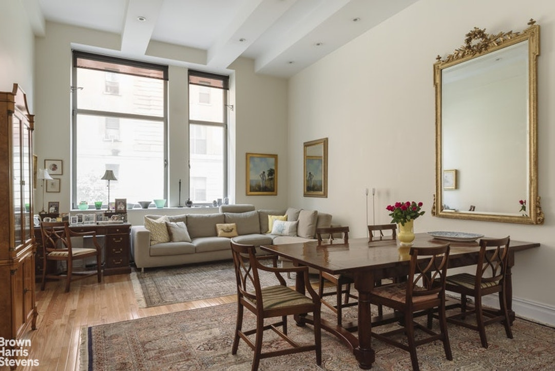 "At over 1,100 square feet with soaring 13.5"" ceilings, this 1 bedroom plus home office with 2 full baths is available for immediate rental in the iconic full service Chelsea Mercantile condominium.The gracious foyer leads into the expansive open kitchen/living/dining space with its oversized south-facing tilt and turn windows. There is maple hardwood flooring throughout, and an abundance of custom closet and storage space. A cook's delight, the kitchen features cherrywood cabinetry complimented by black granite countertops and stainless steel appliances. The home office is smartly outfitted with custom built-ins and is a perfect WFH setup. You'll find more built-ins in the bedroom, and the en-suite limestone bath features a double sink vanity, and a luxurious oversized stall shower.The Chelsea Mercantile offers a 24-hour doorman and concierge, a gym, children's playroom, meeting room, valet services, a magnificent landscaped roof deck and a stunning new lobby. There are washer/dryers on every floor, and the 3rd floor laundry is right outside your front door.This grand building dates from 1908 and was converted to condominiums in 1999. It's public parking garage is accessible directly from the lobby, and Whole Foods is conveniently located on the ground floor.Sorry, no pets."