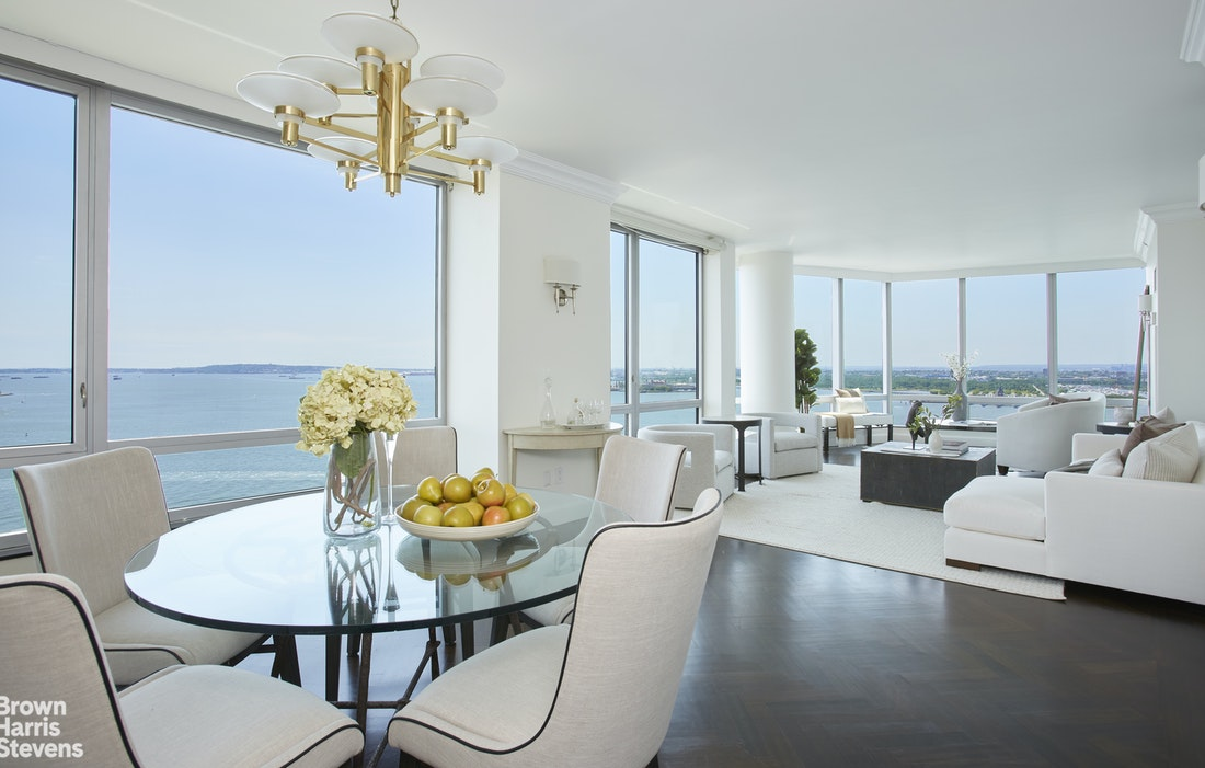 Welcome the Ritz Carlton Residences at 10 West Street. This extremely rare 2 bedroom 2 and half bath G line is now available for sale. From every window are unobstructed and expansive views of the iconic Statue of Liberty, Ellis Island, New York Harbor, Governor's Island, the Verrazano Bridge, Staten Island, Brooklyn and West to New Jersey's distant highlands and the magnificent Hudson River. With floor-to-ceiling windows, and southern exposure this home is light filled all day and has the most spectacular, picturesque sunsets.Boasting the perfect split bedroom floorplan, the south facing grand owner's suite comes with a luxurious 5 piece bath, magnificent closets as well as bird's eye views of Lady Liberty and the NY Harbor. The western facing second bedroom has stunning Hudson River views and ensuite marble bath. The corner great room measures an incredible 38 x 16 feet! The half bath and washer/dryer are located of the expansive entry foyer. A renovated chef's kitchen with top of the line finishes and appliances is ideal for creating delicious fare and entertaining while your guests marvel at the passing boats on the Harbor. All of this is framed by luxurious finishes including picture-perfect herringbone hardwood floors, gracious marble entry foyer, and high-quality hand-crafted millwork.THE BUILDING: Located at the Southern tip of Manhattan, The Ritz-Carlton Residences offer the very highest level of white-glove service with a dedicated team of door and concierge staff, porters, cleaning services and valet parking. Just steps from Wagner Park and the Hudson River Esplanade, this is the crown jewel of lower Manhattan. THE NEIGHBORHOOD: Battery Park City offers a very comfortable quality of life, while remaining convenient to all that one needs on a daily basis. Abundant trees and grass, access to the water, trails to wander, parks and more. Whole Foods, Le District, Eataly, Brookfield Place, The Oculus, Nobu and other fabulous shopping and dining options are jus