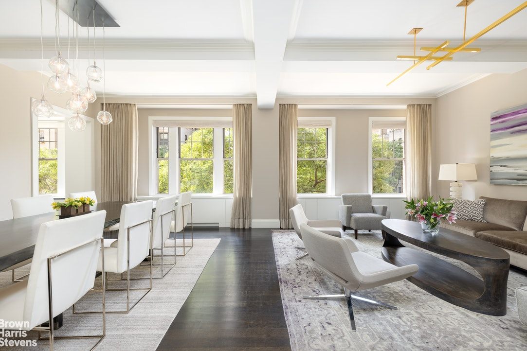 Located on the third floor of a 1917 Gross and Schwartz condominium, this nearly 3,700 square foot home with soaring 10-foot ceilings has been masterfully combined and renovated and is in triple mint condition.The elegant foyer, with a mirrored built-in and custom coat closet leads to the sprawling living area, which is perfect for large scale entertaining. The double wide living and dining room face West over tree-lined West End Avenue and can be opened to the library through pocket doors. The adjacent eat-in kitchen also faces tree lined West End Avenue and is bright and inviting. It is outfitted with Pietra Cardosa countertops, a Calacatta marble backsplash and top-of-the-line appliances including a Sub-Zero refrigerator and six burner Wolf stove. There is an abundance of custom cabinets and storage throughout, an island with wine refrigerator, and a large eat-in area with banquette.The oversized primary bedroom suite boasts a double wide bedroom, a home office big enough for two, custom walk-in closets and a five fixture bathroom with double vanity, separate tub and shower, Dornbracht fixtures and marble floors. A separate wing houses three additional bedrooms - a large corner bedroom with walk-in closet and en-suite bathroom and two other generously proportioned bedrooms with double closets and a shared bath. There is also a laundry room with vented side by side washer and dryer.One of the most unique features of this home is the additional casual entertaining suite, which can be accessed from the apartment or from its own entrance. This loft like space is perfect as a playroom/game room, art studio, home gym and/or staff room. There is a full bathroom, kitchenette and an abundance of storage.This wonderful home is complete with beautiful oak hardwood floors throughout, a powder room for guests, a mudroom with built-in cubbies and beautiful furnishings, which can be purchased separately. Additionally, the apartment has many smart home features including a Sonos