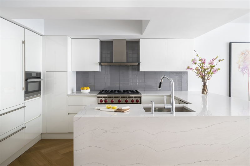 The kitchen features white liquor Scavolini cabinets with Quartz countertops and appliances by Wolf, Miele,and Sub-Zero.